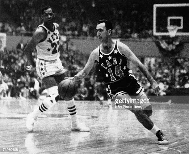 Bob Cousy of the Eastern Conference AllStars drives to the basket during an NBA AllStar game circa 1950 NOTE TO USER User expressly acknowledges that...