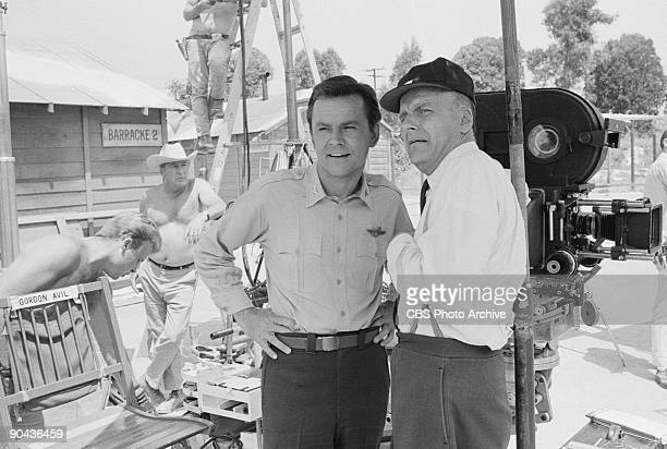 HEROES Bob Crane as Col Robert E Hogan left and Werner Klemperer as Col Wilhelm Klink in between scenes of A Klink A Bomb And A Short Fuse an episode...