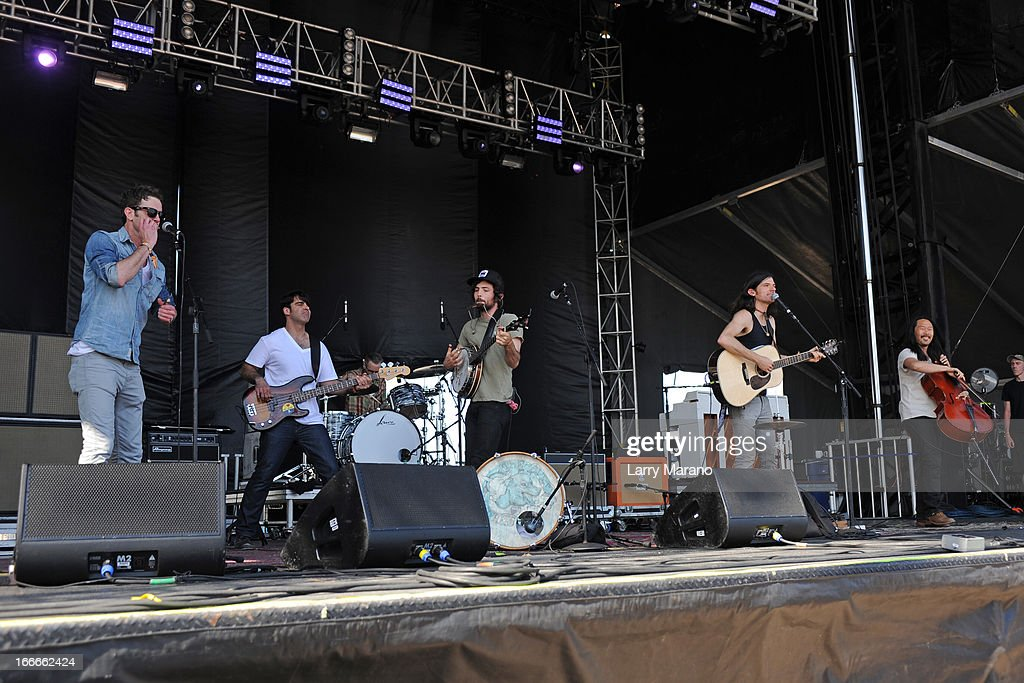 Bob Crawford, Mike Marsh, Scott Avett, Seth Avett and Joe Kwon of The Avett Brothers perform during the Rock The Oceans Tortuga Festival on April 14, 2013 in Fort Lauderdale, Florida.