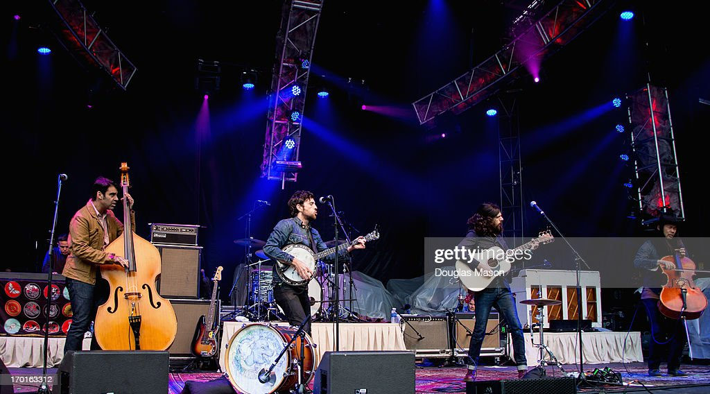 Bob Crawford, Mike Marsh, Scott Avett, Seth Avett and Joe Kwon of the Avett Brothers performs during the 9th Annual Mountain Jam at Hunter Mountain on June 7, 2013 in Hunter, New York.