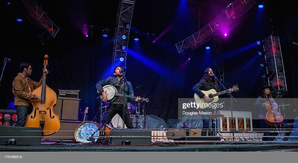 Bob Crawford, Mike Marsh, Scott Avett, Seth Avett and Joe Kwon of the Avett Brothers performs during the 9th Annual Mountain Jam at Hunter Mountain on June 7, 2013 in Hunter, New York.