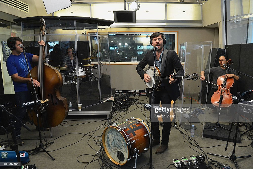 Bob Crawford, Scott Avett and Joe Kwon of The Avett Brothers perform at SiriusXM Studios on September 26, 2013 in New York City.