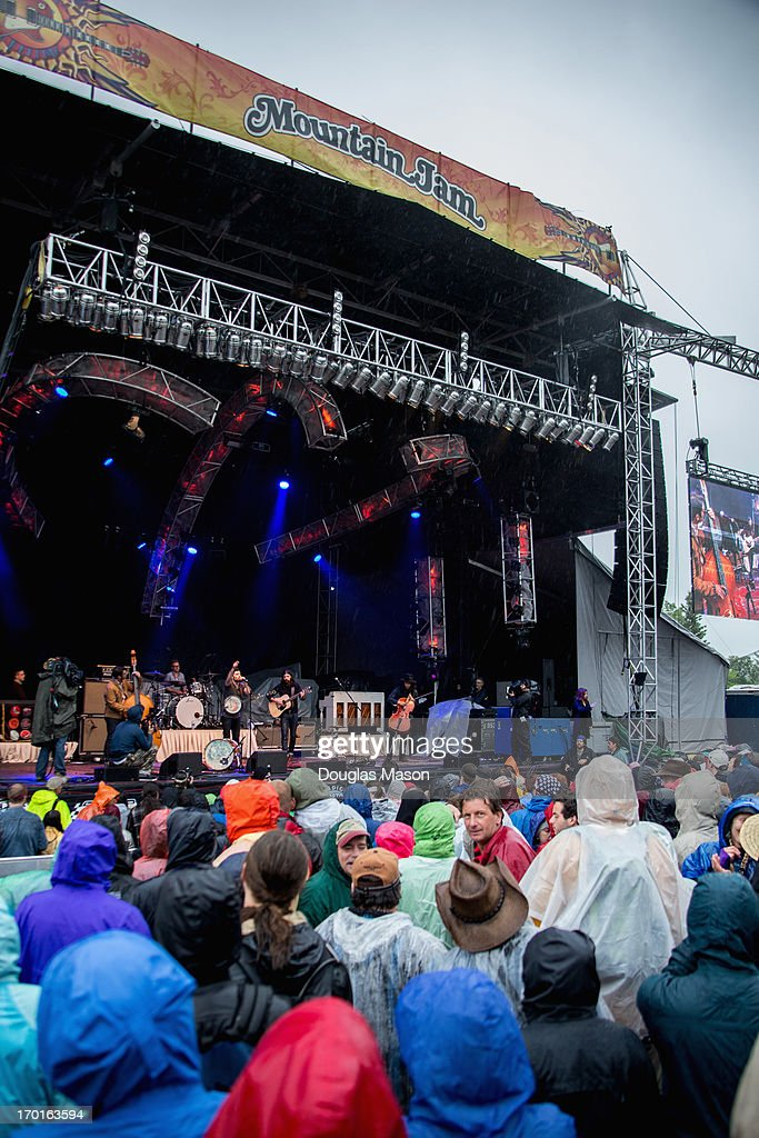 Bob Crawford, Scott Avett, Seth Avett and Joe Kwon of The Avett Brothers performs during the 9th Annual Mountain Jam at Hunter Mountain on June 7, 2013 in Hunter, New York.