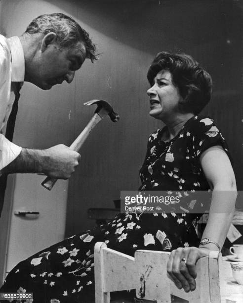 Bob Davis as the alcoholic doctor reaches a terrifying moment In his incoherent rage as his wife Lola played by Marion Neet cowers in fear and...