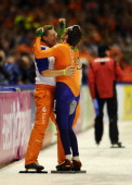 Bob de Jong of the Netherlands celebrates with his coach Jillert Anema after clocking the fastest time at the 10000m race at the Essent ISU World...