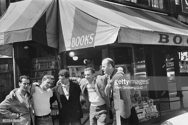 Bob Donlon (Rob Donnelly), Neal Cassady, Allen Ginsberg, Robert LaVigne, and Lawrence Ferlinghetti (left to right) stand outside Ferlinghetti's City Lights Bookstore in San Francisco, California, Spring 1956.