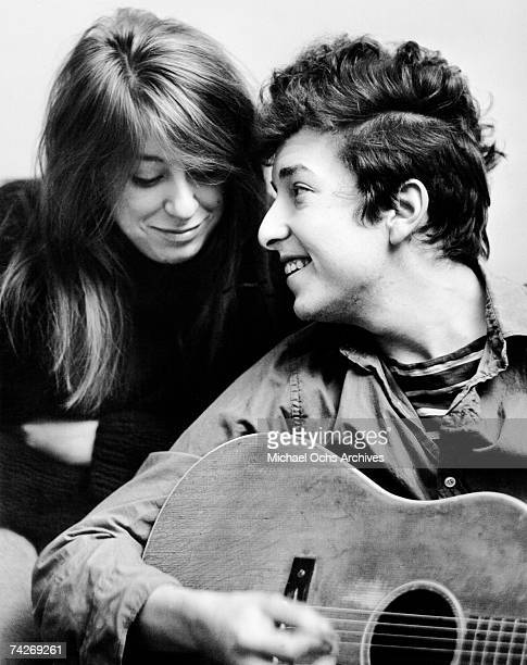 Bob Dylan holding his acoustic guitar and his girlfriend Suze Rotolo pose for a portrait in September 1961 in New York City New York