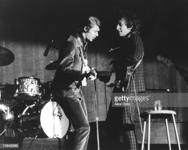 Bob Dylan and Robbie Robertson play a Fender Telecaster electric guitars as they performs on stage at the Westchester County Center on February 5...