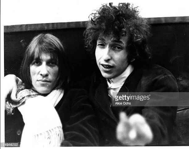 Bob Dylan and songwriter Doug Sahm joke around on a couch in early 1966 in New York