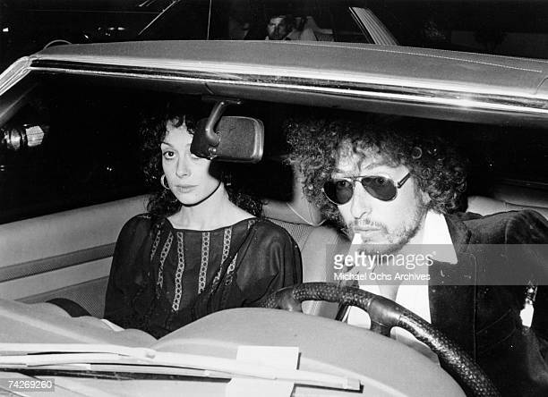 Bob Dylan arrives at an event driving a Mercedes with a woman in the passenger seat in 1976
