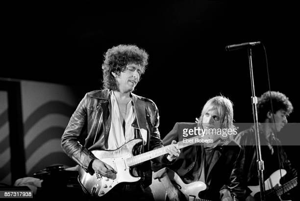 Bob Dylan performing with Tom Petty and The Heartbreakers at Farm Aid in ChampaignIllinois on September 22 1985