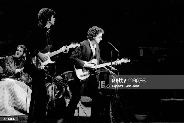 Bob Dylan performs live on stage with Robbie Robertson and Levon Helm of The Band at Madison Square Garden New York as part of his 1974 Tour Of...