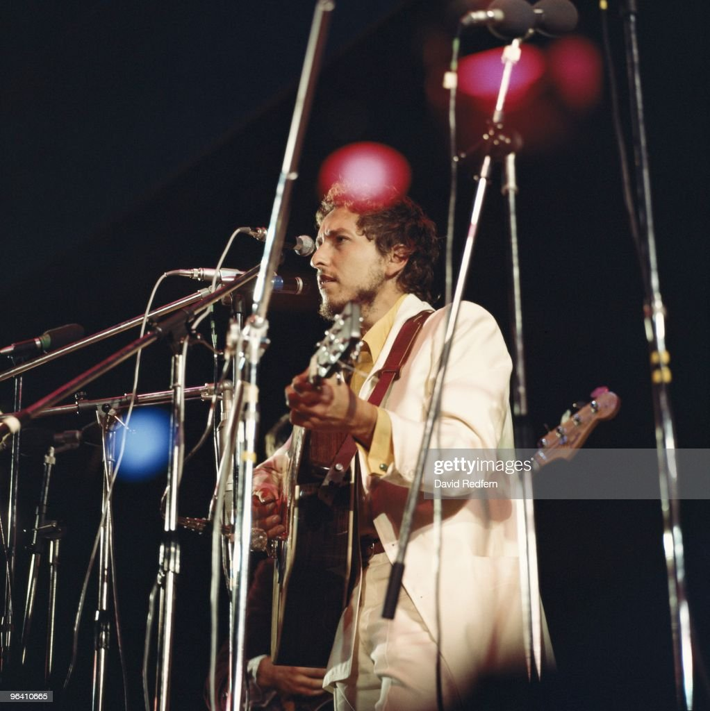 <a gi-track='captionPersonalityLinkClicked' href=/galleries/search?phrase=Bob+Dylan&family=editorial&specificpeople=203289 ng-click='$event.stopPropagation()'>Bob Dylan</a> performs on stage at the Isle Of Wight Festival on August 31st 1969. Image is part of David Redfern Premium Collection.