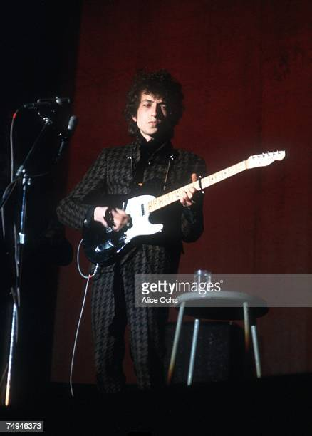 Bob Dylan plays a Fender Telecaster electric guitar as he performs on stage at the Westchester County Center on February 5 1966 in White Plains New...