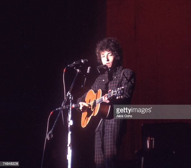 Bob Dylan plays a Gibson acoustic guitar as he performs on stage at the Westchester County Center on February 5 1966 in White Plains New York