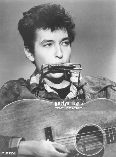 Bob Dylan plays harmonica and acoustic guitar in this headshot from September 1962 in New York City New York