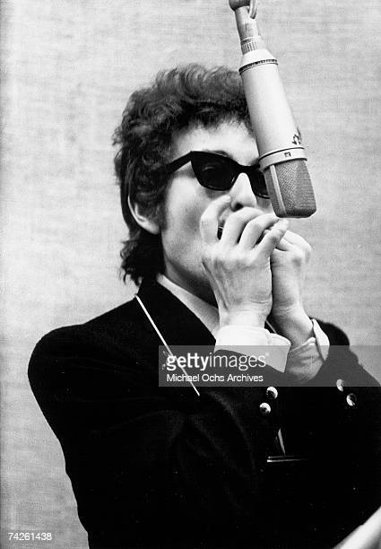 Bob Dylan plays harmonica in to a microphone to record his album 'Bringing It All Back Home' on January 13th 1965 in Columbia's Studio A in New York...
