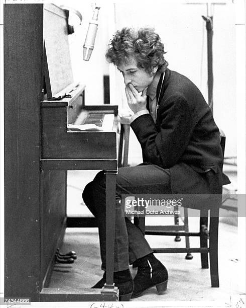 Bob Dylan sits at the piano during the recording of the album 'Highway 61 Revisited' in Columbia's Studio A in the summer of 1965 in New York City...