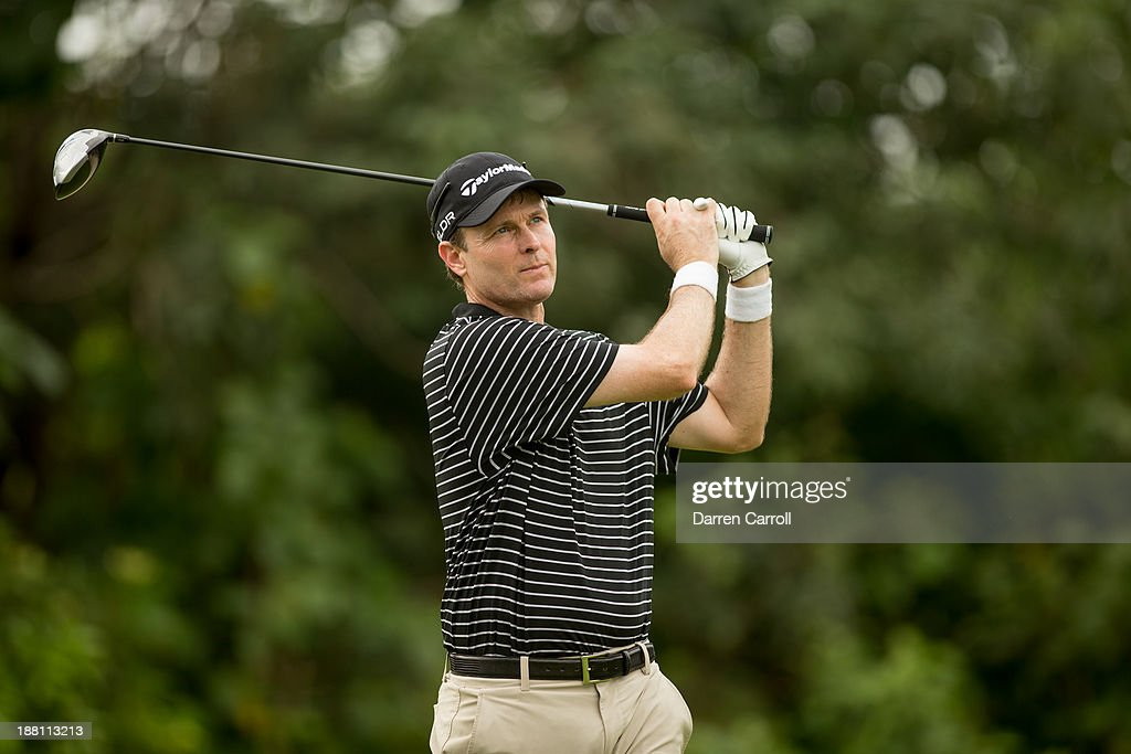 Bob Estes of the United States plays a tee shot at the seventh hole during continuation of the first round of the 2013 OHL Classic at Mayakoba, played at El Camaleon Golf Club on November 15, 2013 in Playa Del Carmen, Mexico.