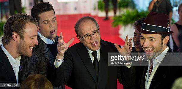 TORONTO SEPTEMBER 21 Bob Ezrin hams it up with The Tenors while speaking to the media following the unveiling of his plaque Canada's Walk of Fame...