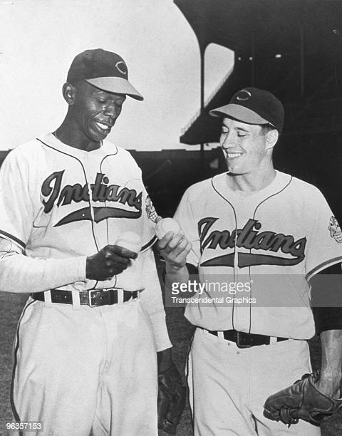 Bob Feller right and Satchel Paige pitchers for the Cleveland Indians in 1948 discuss grips before a game at Municipal Stadium in Cleveland Ohio