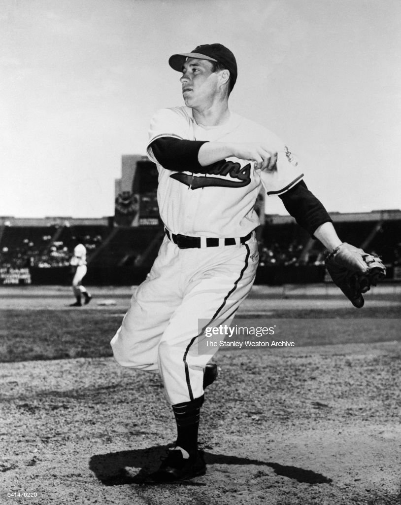 Bob Feller warms up before a game at Municipal Stadium in Cleveland (The winningest pitcher in Cleveland Indians history), Cleveland, Ohio, 1949.