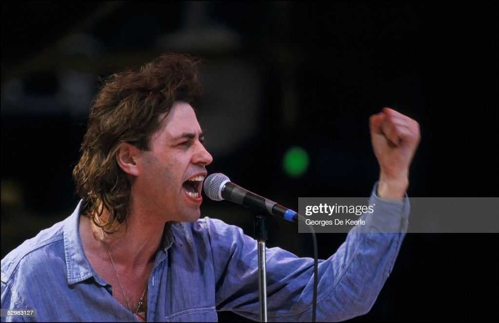 Bob Geldof performs on stage during the Live Aid concert at Wembley Stadium on 13 July, 1985 in London, England. Live Aid was watched by millions around the world on television and raised vast quantities of donated money to help relieve a severe famine in Ethiopia.