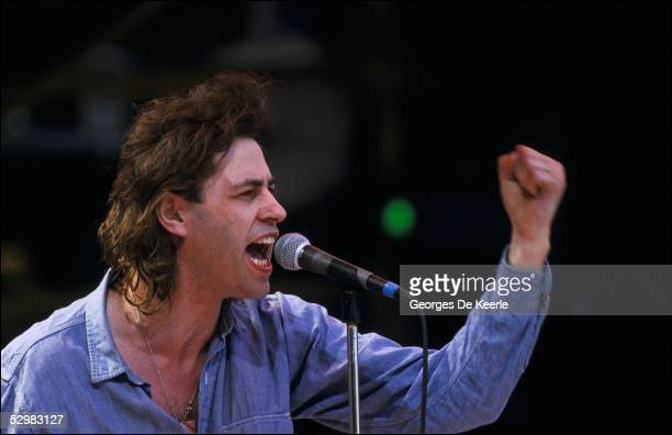 Bob Geldof performs on stage during the Live Aid concert at Wembley Stadium on 13 July 1985 in London England Live Aid was watched by millions around...