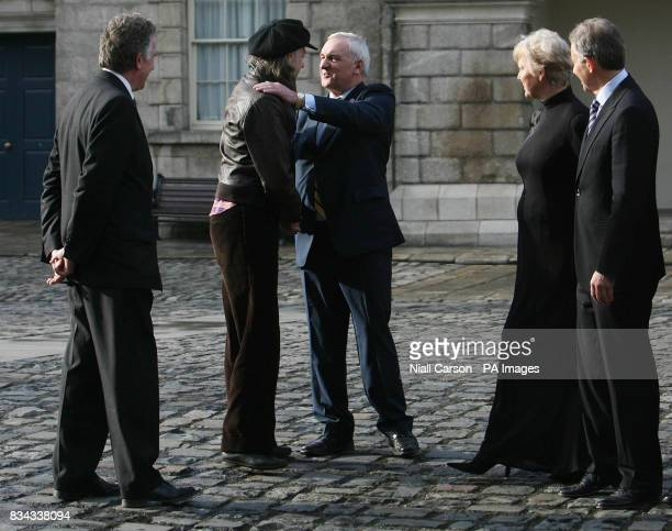 Bob Geldoff greets outgoing Irish premier Bertie Ahern watched by the chairman of Turn the Tide of Suicide Noel Smyth left RTE Broadcaster Marian...