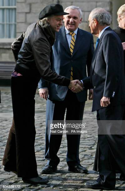 Bob Geldoff left greets US Senator George Mitchell with outgoing Irish premier Bertie Ahern during a meeting at Dublin Castle for a gala dinner which...