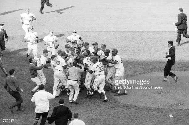Bob Gibson of the St Louis Cardinals being mobbed by his teammates after winning Game 7 of the 1964 World Series against the New York Yankees on...