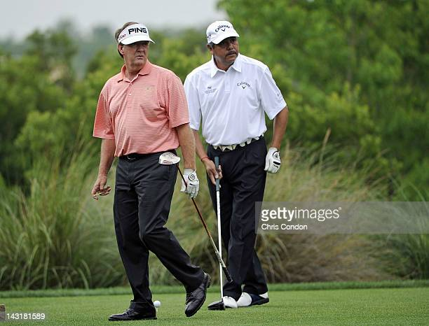 Bob Gilder and Eduardo Romero of Argentina watch a tee shot o the 4th hole during the first round of the Legends Division at the Liberty Mutual...