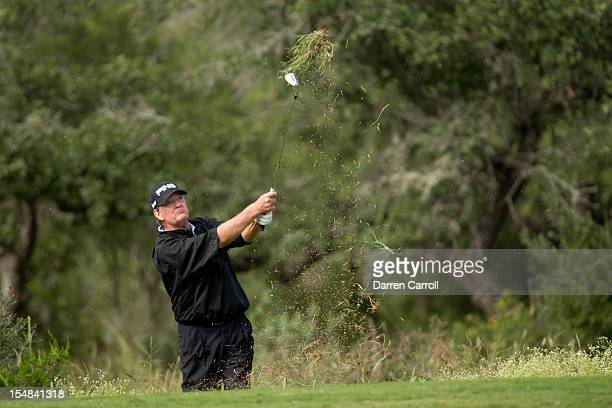 Bob Gilder plays a shot from the rough at the 17th hole during the second round of the 2012 ATT Championship at the Canyons Course at TPC San Antonio...