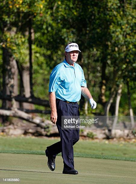Bob Gilder walks on a green during the continuation of the first round of the Mississippi Gulf Resort Classic held at Fallen Oak Golf Club on March...