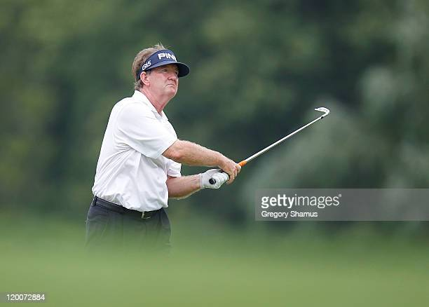 Bob Gilder watches his shot from the 13th fairway during the second round of the United States Senior Open at the Inverness Club on July 29 2011 in...