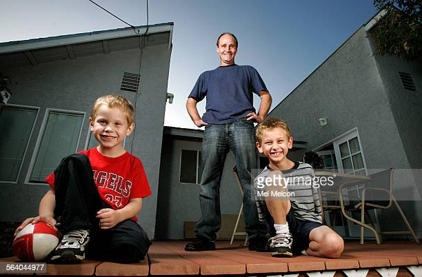 Bob Golub stands on deck located in backyard of his home in West Hollywood In foreground are his two sons Parker left and Peyton 8 Golub used his...