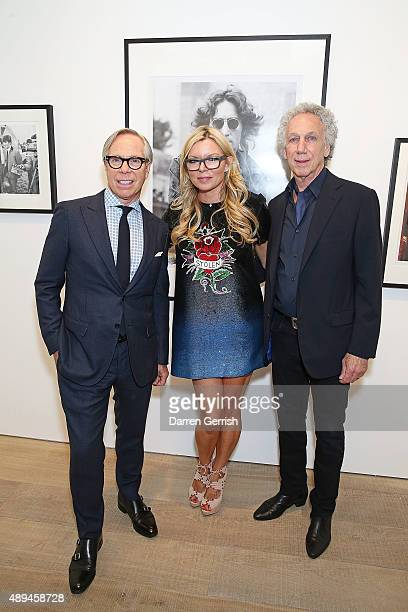 Bob Gruen Fru Tholstrup and Tommy Hilfiger attend as Tommy Hilfiger and Jeffrey Deitch present 'Rock Style' at the S2 Gallery during London Fashion...