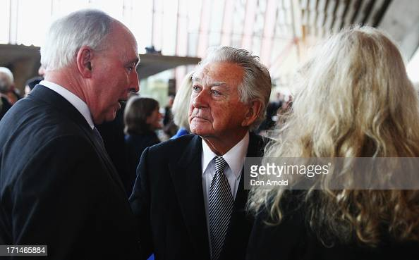 Bob Hawke talks with Paul Keating and Annita Keating as they attend a ...