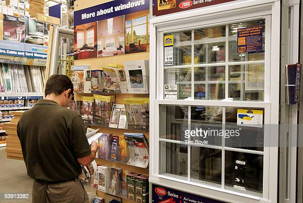 Bob Henry shops for windows at a Lowe's home improvement store September 1 2005 in Lincolnwood Illinois Home building suppliers and supplies such as...