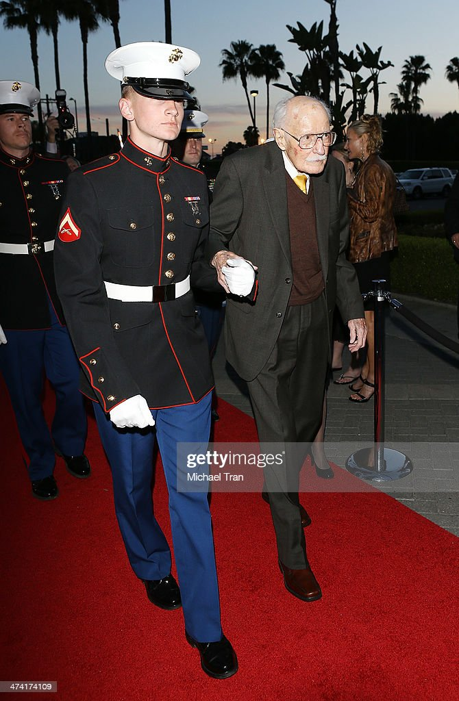 Bob Hoover (R) arrives at the Los Angeles premiere of 'Bob Hoover's Legacy' held at Paramount Theater on the Paramount Studios lot on February 21, 2014 in Hollywood, California.