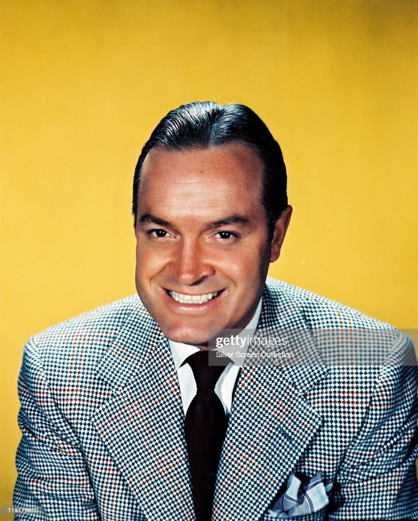 <a gi-track='captionPersonalityLinkClicked' href=/galleries/search?phrase=Bob+Hope+-+Comedian&family=editorial&specificpeople=70010 ng-click='$event.stopPropagation()'>Bob Hope</a> (1903-2003), British actor and comedian, smiling in a studio portrait, against a yellow background, circa 1950.