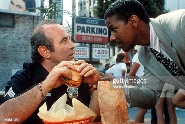 Bob Hoskins is startled by Denzel Washington in a scene from the film 'Heart Condition' 1990