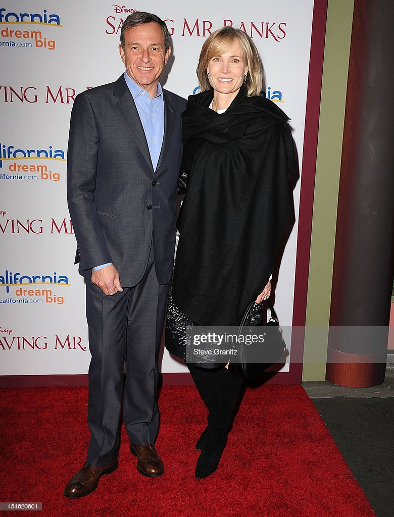 Bob Iger and Willow Bay arrives at the 'Saving Mr. Banks' - Los Angeles Premiere at Walt Disney Studios on December 9, 2013 in Burbank, California.