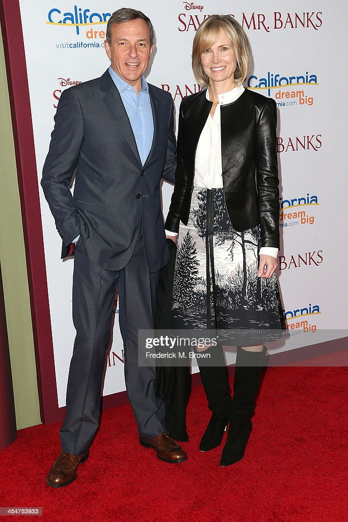 Bob Iger (L) and Willow Bay attend the Premiere of Disney's 'Saving Mr. Banks' at Walt Disney Studios on December 9, 2013 in Burbank, California.