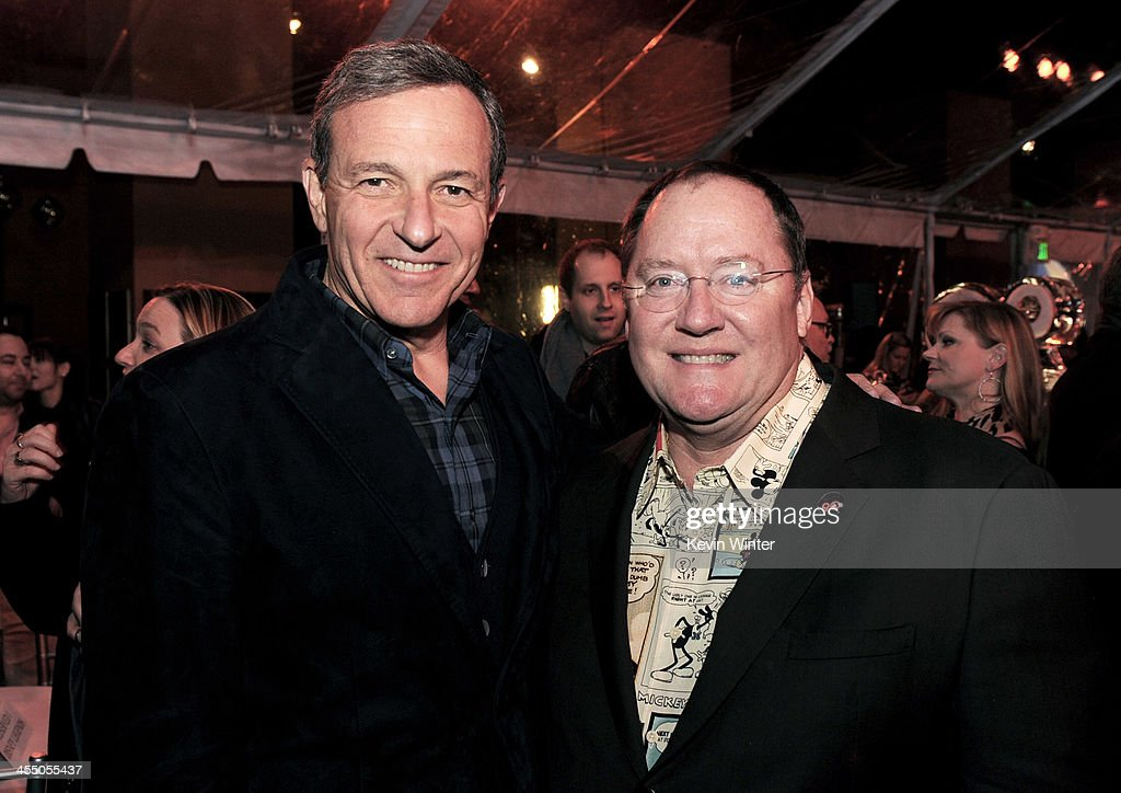 Bob Iger, Chairman and CEO, The Walt Disney Company (L) and John Lasseter, Chief Creative Officer, Pixar and Walt Disney Animation Studios pose at a reception to celebrate 90 Years of Disney animation at The Walt Disney Studios on December 10, 2013 in Burbank, California.