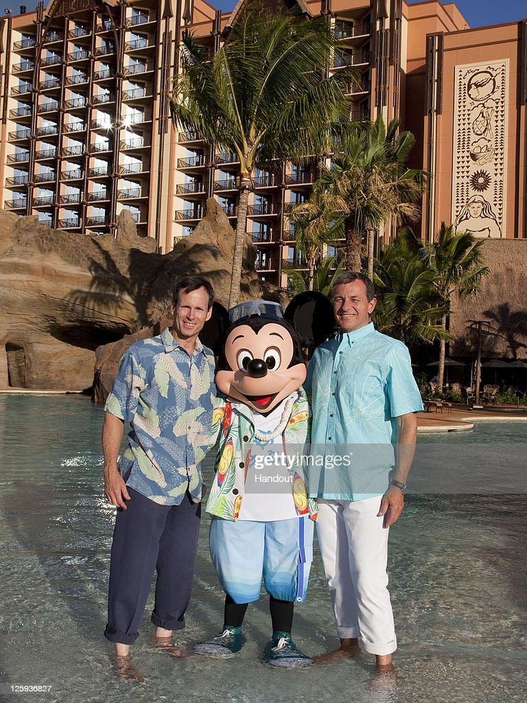 Bob Iger President and CEO The Walt Disney Company and Tom Staggs Chairman Walt Disney Parks and Resorts are joined by Mickey Mouse as final...