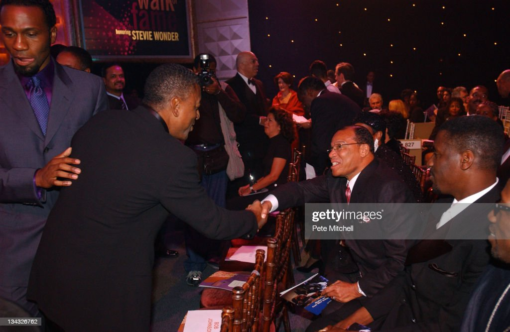Bob Johnson and <a gi-track='captionPersonalityLinkClicked' href=/galleries/search?phrase=Louis+Farrakhan&family=editorial&specificpeople=215023 ng-click='$event.stopPropagation()'>Louis Farrakhan</a>, before the BET Walk of Fame show honoring <a gi-track='captionPersonalityLinkClicked' href=/galleries/search?phrase=Stevie+Wonder&family=editorial&specificpeople=171911 ng-click='$event.stopPropagation()'>Stevie Wonder</a>.