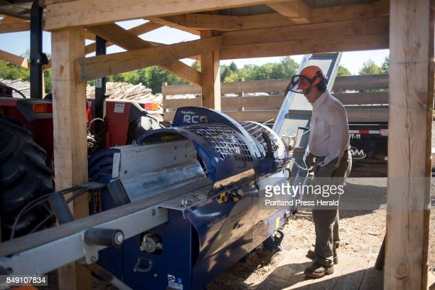 Bob Jordan cuts beech for firewood at Treeline Inc The company which is family run was one of the companies that depended on the Stored Solar plant...