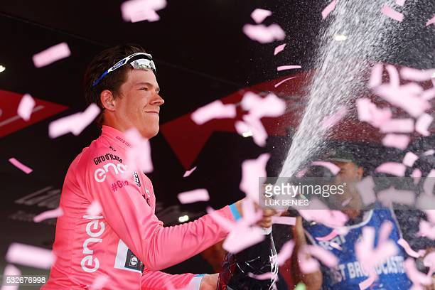 Bob Jungels of Etixx Quick Step team celebrates the pink jersey of the overall leader on the podium of the 12th stage of the 99th Giro d'Italia Tour...