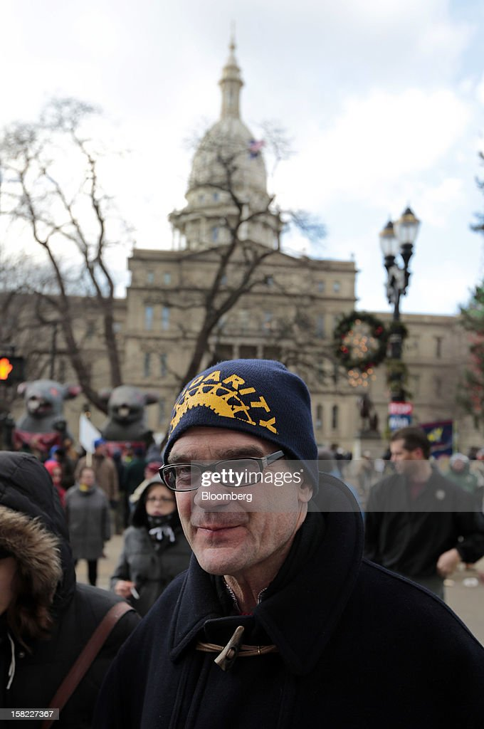 Bob King, president of the United Auto Workers (UAW) union, attends a demonstration outside the Capitol building in Lansing, Michigan, U.S., on Tuesday, Dec. 11, 2012. Michigan lawmakers approved bills to prohibit mandatory union dues in workplaces as thousands of chanting protesters thronged the Capitol. Photographer: Jeff Kowalsky/Bloomberg via Getty Images